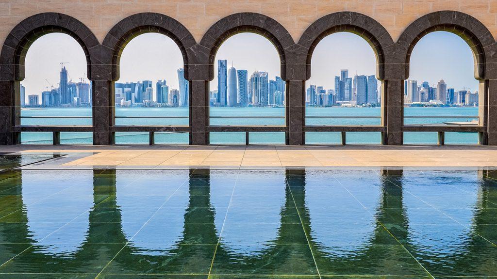 Doha skyline seen through the arches at the Museum of Islamic art, Doha, Qatar