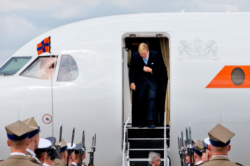 Dutch King Willem-Alexander and Queen Maxima (unseen) arrive in a Fokker 70 PH KBX government's plane at the airport Frederic Chopin in Warsaw, Poland, 24 June 2014 for their first state visit from 24 to 25 June. Photo: Patrick van Katwijk / NETHERLANDS AND FRANCE; OUT -NOWIRESERVICE-