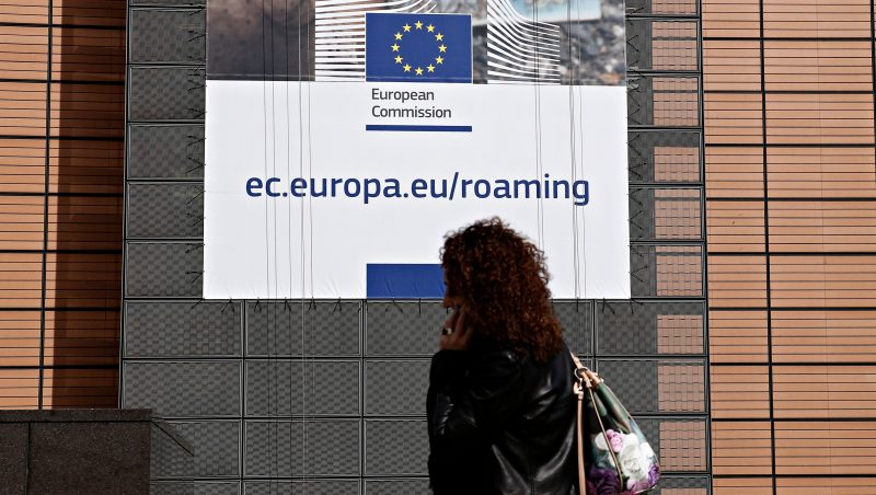 People walk in front of Berlaymont building, headquarters of the European Commission, in Brussels, Belgium on Jun. 12, 2017. Roam Like at Home rules enter into force on 15 June 2017. People will pay domestic prices, irrespective of where they are travelling in the EU for phone-calls, SMS and mobile internet.