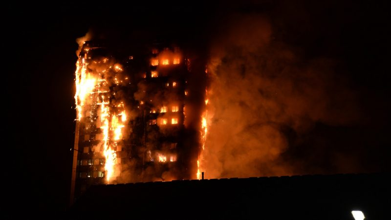 """This handout image received by local resident Giulio Thuburn early on June 14, 2017 shows flames engulfing a 27-storey block of flats in west London. The fire brigade said 40 fire engines and 200 firefighters had been called to the blaze in Grenfell Tower, which has 120 flats. / AFP PHOTO / Giulio Thuburn / Giulio Thuburn / -----EDITORS NOTE --- RESTRICTED TO EDITORIAL USE - MANDATORY CREDIT """"AFP PHOTO / Giulio Thuburn"""" - NO MARKETING - NO ADVERTISING CAMPAIGNS - DISTRIBUTED AS A SERVICE TO CLIENTS - NO ARCHIVES"""