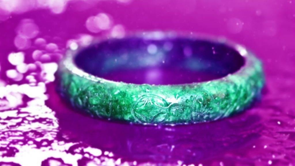 Traditional chinese jade green stone carve bracelet on granito scene