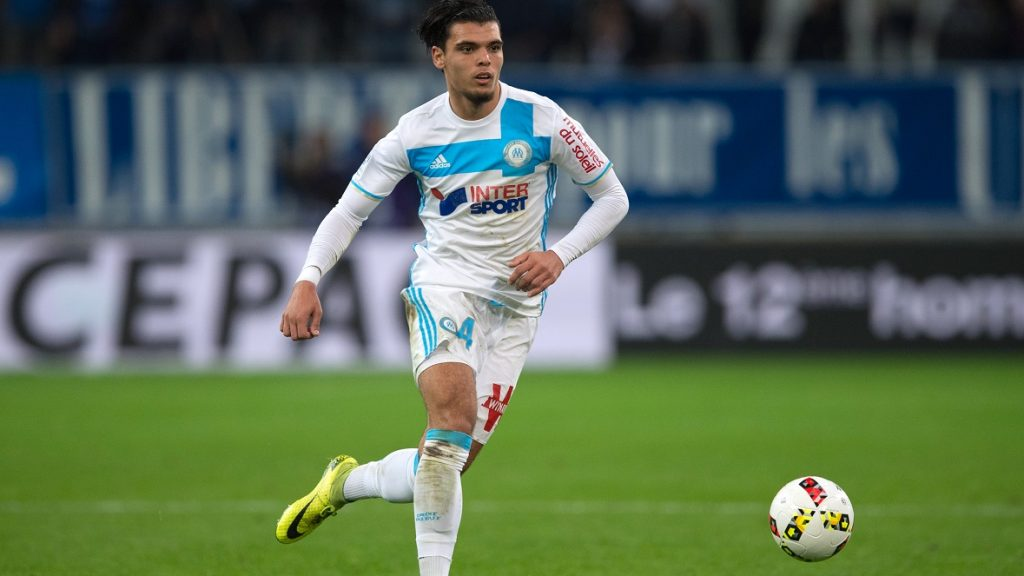 Olympique de Marseille's Dutch defender Karim Rekik runs with the ball during the French L1 football match between Olympique de Marseille and Stade Malherbe de Caen on November 20, 2016 at the Velodrome stadium in Marseille, southern France.  / AFP PHOTO / BERTRAND LANGLOIS
