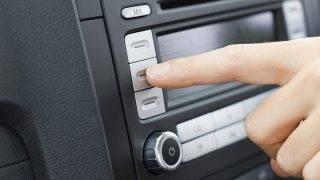 Pushing car radio button