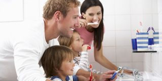 42254324 - family in bathroom brushing teeth