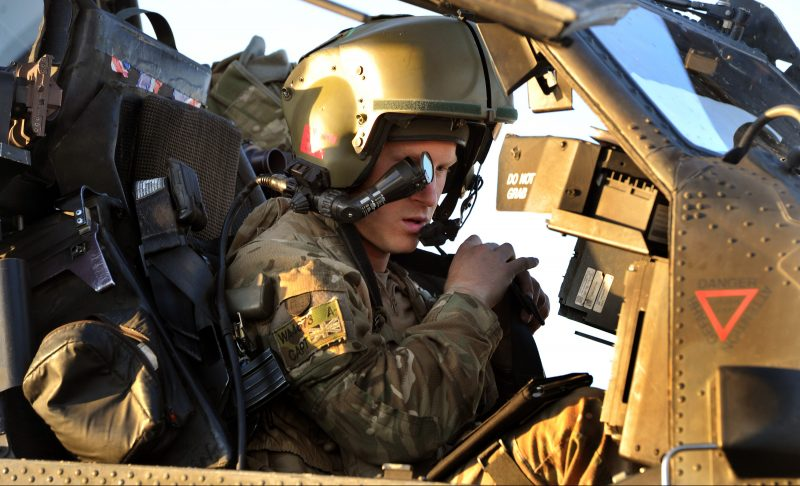 This picture taken on November 2, 2012 shows Britain's Prince Harry wearing wears his monocle gun sight as he sits in the front seat of his cockpit at Camp Bastion in Afghanistan's Helmand Province, where he was serving as an Apache Helicopter Pilot/Gunner with 662 Sqd Army Air Corps. Britain's Prince Harry confirmed he killed Taliban fighters during his stint as a helicopter gunner in Afghanistan, it can be reported after he completed his tour of duty on January 21, 2013.  AFP PHOTO / POOL / JOHN STILLWELL / AFP PHOTO / POOL / JOHN STILLWELL