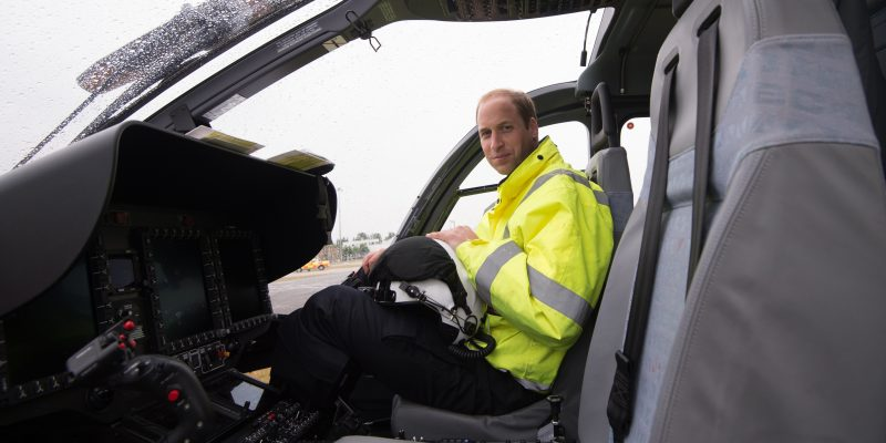 Britain's Prince William, The Duke of Cambridge poses in the cockpit of a helicopter air ambulance he begins his new job with the East Anglian Air Ambulance (EAAA) at Cambridge Airport on July 13, 2015. The former RAF search and rescue helicopter pilot will work as a co-pilot transporting patients to hospital from emergencies ranging from road accidents to heart attacks.  AFP PHOTO /  POOL / Stefan Rousseau / AFP PHOTO / POOL / STEFAN ROUSSEAU