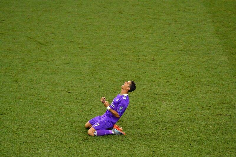 (FILES) This file photo taken on June 03, 2017 shows  Real Madrid's Portuguese striker Cristiano Ronaldo celebrating after winning the UEFA Champions League final football match between Juventus and Real Madrid at The Principality Stadium in Cardiff, south Wales. State prosecutors have filed a complaint on June 13, 2017 against the Portuguese star, who they accuse of taking advantage of a corporate structure to defraud the Spanish Treasury of 14.7 million euros. / AFP PHOTO / Ben STANSALL