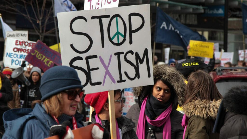 CANADA, Toronto: A protester holds a sign which reads Stop