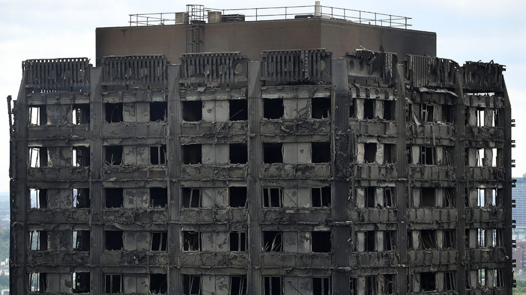 LONDON, ENGLAND - JUNE 15:  A general view of the fire damaged exterior of Grenfell Tower on June 15, 2017 in London, England. At least 17 people have been confirmed dead and dozens missing, after the 24 storey residential Grenfell Tower block in Latimer Road was engulfed in flames in the early hours of June 14. The number of fatalities are expected to rise.  (Photo by Dan Kitwood/Getty Images)