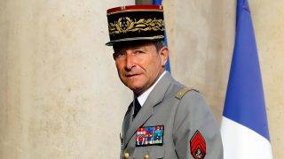 """(FILES) This file photo taken on August 11, 2016 shows Chief of the Defence Staff French army General Pierre de Villiers arriving at the Elysee Palace for a defence council in Paris. French military chief Pierre de Villiers announced to AFP in a press release on July 19, 2017 he presented his resignation to French President Emmanuel Macron """"Who accepted it"""". / AFP PHOTO / PATRICK KOVARIK"""