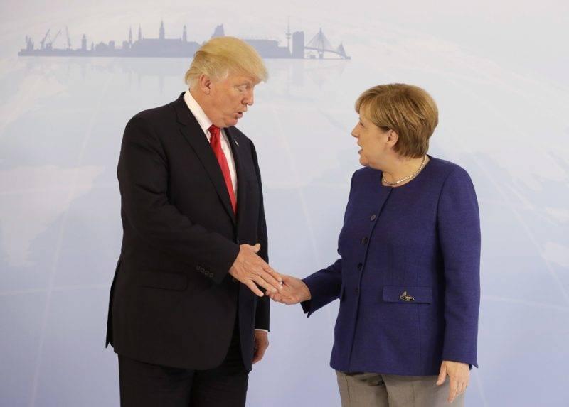 Hamburg, 2017. július 6.Angela Merkel német kancellár fogadja kétoldalú tárgyalásukon Donald Trump amerikai elnököt a világ 19 legfejlettebb gazdaságú és vezető feltörekvő országát, valamint az Európai Uniót tömörítő húszas csoport, a G20 hamburgi csúcstalálkozója előtt egy nappal, 2017. július 6-án. (MTI/AP pool/Matthias Schrader)