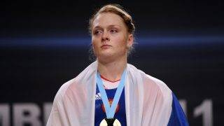 Russia's Oxana Slivenko (gold medalist) poses on the podium of the 2011 World Weightlifting Championships' finals in the 69 kg women's weight class on November 9, 2011 in Chessy, eastern suburb of Paris.  AFP PHOTO / BERTRAND GUAY / AFP PHOTO / BERTRAND GUAY