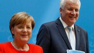German Chancellor and head of the Christian Democrats party, Angela Merkel (L) and Horst Seehofer, leader of Bavarian sister Party CSU, present their parties' electoral programmes for the September 24 parliamentary election during a press conference on July 3, 2017 in Berlin. / AFP PHOTO / Odd ANDERSEN