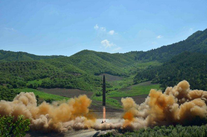 """This picture taken and released on July 4, 2017 by North Korea's official Korean Central News Agency (KCNA) shows the test-fire of the intercontinental ballistic missile Hwasong-14 at an undisclosed location. North Korea declared on July 4 it had successfully tested its first intercontinental ballistic missile -- a watershed moment in its push to develop a nuclear weapon capable of hitting the mainland United States. / AFP PHOTO / KCNA VIA KNS / STR / South Korea OUT / REPUBLIC OF KOREA OUT   ---EDITORS NOTE--- RESTRICTED TO EDITORIAL USE - MANDATORY CREDIT """"AFP PHOTO/KCNA VIA KNS"""" - NO MARKETING NO ADVERTISING CAMPAIGNS - DISTRIBUTED AS A SERVICE TO CLIENTS THIS PICTURE WAS MADE AVAILABLE BY A THIRD PARTY. AFP CAN NOT INDEPENDENTLY VERIFY THE AUTHENTICITY, LOCATION, DATE AND CONTENT OF THIS IMAGE. THIS PHOTO IS DISTRIBUTED EXACTLY AS RECEIVED BY AFP.   /"""