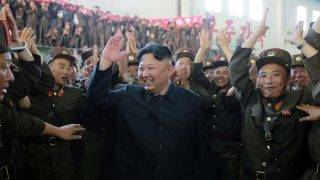 """This picture taken on July 4, 2017 and released from North Korea's official Korean Central News Agency (KCNA) on July 5, 2017 shows North Korean leader Kim Jong-Un (C) celebrating the successful test-fire of the intercontinental ballistic missile Hwasong-14 at an undisclosed location. South Korea and the United States fired off missiles on July 5 simulating a precision strike against North Korea's leadership, in response to a landmark ICBM test described by Kim Jong-Un as a gift to """"American bastards"""". / AFP PHOTO / KCNA VIA KNS / STR / South Korea OUT / REPUBLIC OF KOREA OUT   ---EDITORS NOTE--- RESTRICTED TO EDITORIAL USE - MANDATORY CREDIT """"AFP PHOTO/KCNA VIA KNS"""" - NO MARKETING NO ADVERTISING CAMPAIGNS - DISTRIBUTED AS A SERVICE TO CLIENTS THIS PICTURE WAS MADE AVAILABLE BY A THIRD PARTY. AFP CAN NOT INDEPENDENTLY VERIFY THE AUTHENTICITY, LOCATION, DATE AND CONTENT OF THIS IMAGE. THIS PHOTO IS DISTRIBUTED EXACTLY AS RECEIVED BY AFP.    /"""