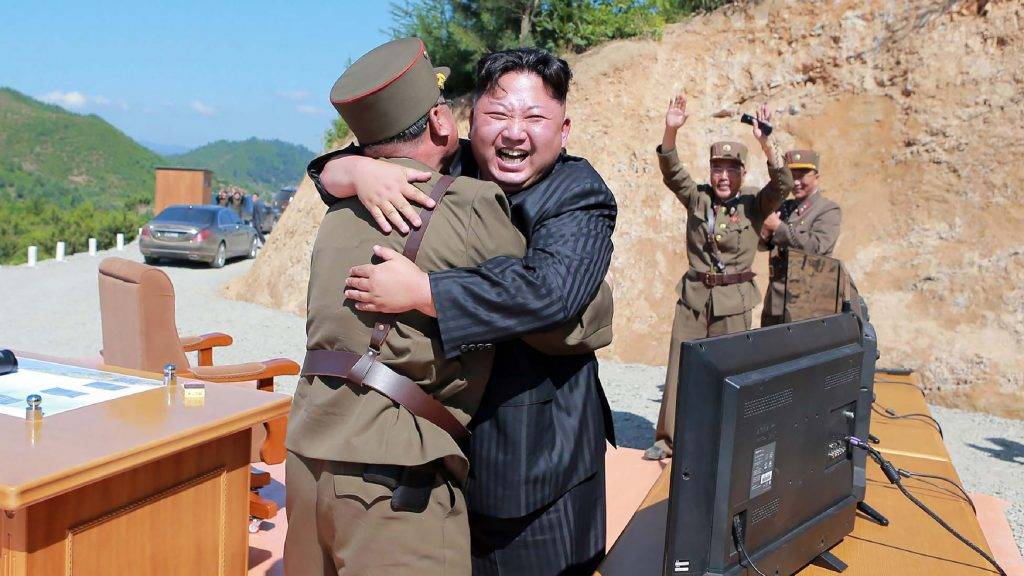 """This picture taken on July 4, 2017 and released by North Korea's official Korean Central News Agency (KCNA) on July 5, 2017 shows North Korean leader Kim Jong-Un (C) celebrating the successful test-fire of the intercontinental ballistic missile Hwasong-14 at an undisclosed location. South Korea and the United States fired off missiles on July 5 simulating a precision strike against North Korea's leadership, in response to a landmark ICBM test described by Kim Jong-Un as a gift to """"American bastards"""". / AFP PHOTO / KCNA VIA KNS / STR / South Korea OUT / REPUBLIC OF KOREA OUT   ---EDITORS NOTE--- RESTRICTED TO EDITORIAL USE - MANDATORY CREDIT """"AFP PHOTO/KCNA VIA KNS"""" - NO MARKETING NO ADVERTISING CAMPAIGNS - DISTRIBUTED AS A SERVICE TO CLIENTS THIS PICTURE WAS MADE AVAILABLE BY A THIRD PARTY. AFP CAN NOT INDEPENDENTLY VERIFY THE AUTHENTICITY, LOCATION, DATE AND CONTENT OF THIS IMAGE. THIS PHOTO IS DISTRIBUTED EXACTLY AS RECEIVED BY AFP.    /"""