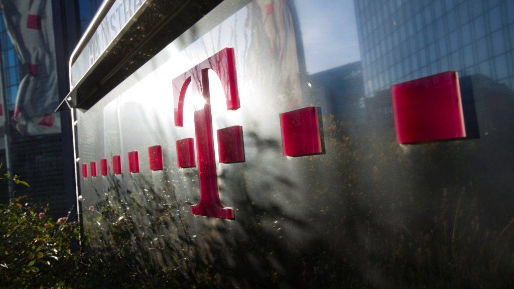 View of the company logo in front of the company headquarters of T-Systems in Frankfurt Main, Germany, 02 December 2013. Photo: FRANK RUMPENHORST/dpa