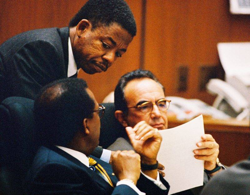 Defense attorney Carl Douglas (C) confers with defense team members Johnnie Cochran (L) and Robert Shapiro during testimony in the O.J. Simpson Criminal Trial June 1, 1995 in Los Angeles. (Photo by Lee Celano/WireImage)