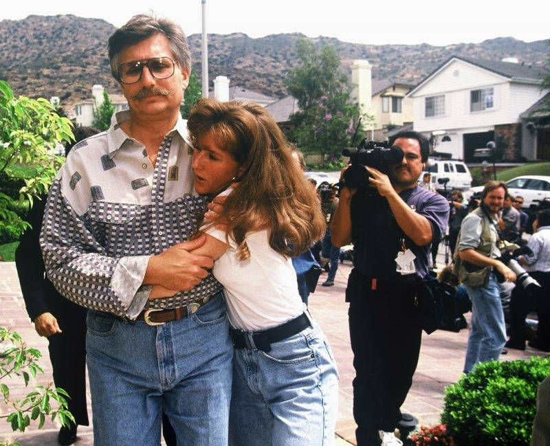 Fred and Kim Goldman, father and sister of Ronald Goldman, appear in front of the media June 15, 1994 at their home in Agoura Hills, CA, following the murder of Ronald and O.J. Simpson's ex-wife Nicole Brown Simpson. (Photo by Lee Celano/WireImage)