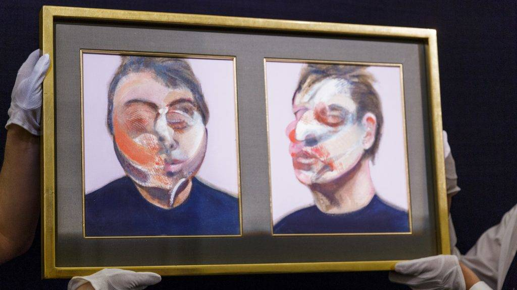 LONDON, ENGLAND - APRIL 08:  Technicians install Francis Bacon's Two Studies for a Self-Portrait, 1970, (est $22-30million)  at Sotheby's on April 8, 2016 in London, England. The work will be sold as part of Sotheby's Contemporary Art Evening Auction in New York on the 11th May 2016.  (Photo by Tristan Fewings/Getty Images for Sotheby's)