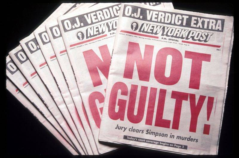 """239068 01: The New York Post displays a """"Not Guilty!"""" headline October 3, 1995 in New York City. Orenthal James Simpson was on trial for the murder of his ex-wife Nicole Brown Simpson and Ronald Goldman but was later acquitted after a nationally televised trial. (Photo by Evan Agostini/Liaison)"""