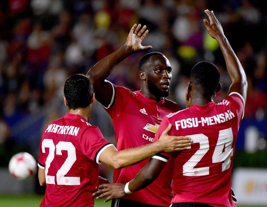 CARSON, CA - JULY 15:  Romelo Lukaku #9 of Manchester United celebrates a goal from Anthony Martial #11 with Timothy Fosu-Mensah #24 and Henrikh Mkhitaryan #22 to take a 5-0 lead during the second half at StubHub Center on July 15, 2017 in Carson, California.  Manchester United would win the match 5-2.  (Photo by Harry How/Getty Images)