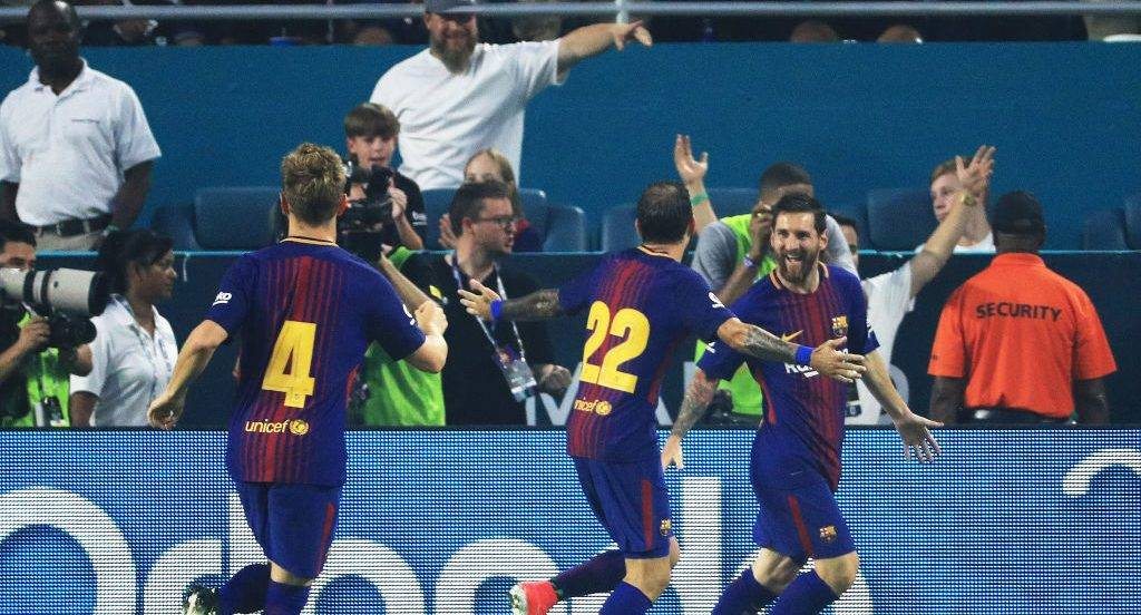 MIAMI GARDENS, FL - JULY 29:  Lionel Messi #10 of Barcelona celebrates his goal with teammates in the first half against the Real Madrid during their International Champions Cup 2017 match at Hard Rock Stadium on July 29, 2017 in Miami Gardens, Florida.  (Photo by Mike Ehrmann/Getty Images)