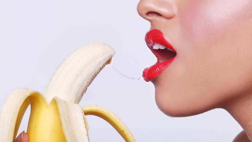 Suggestive Sensual Woman Preparing to Eat a Banana