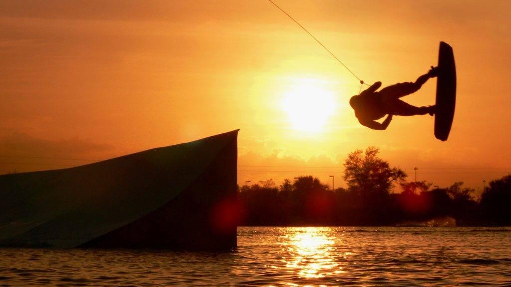Jumping Wake boarding at sunset