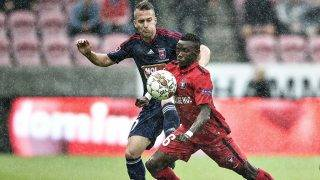 FC Midtjylland's Rilwan Hassan (R) and Videoton FC Bodi Adam vie for the ball during the UEFA Europa League third round second leg qualification football match against Videoton FC at the MCH-Arena in Herning, on Augsut 4, 2016. / AFP PHOTO / Scanpix Denmark AND Scanpix / Henning Bagger / Denmark OUT