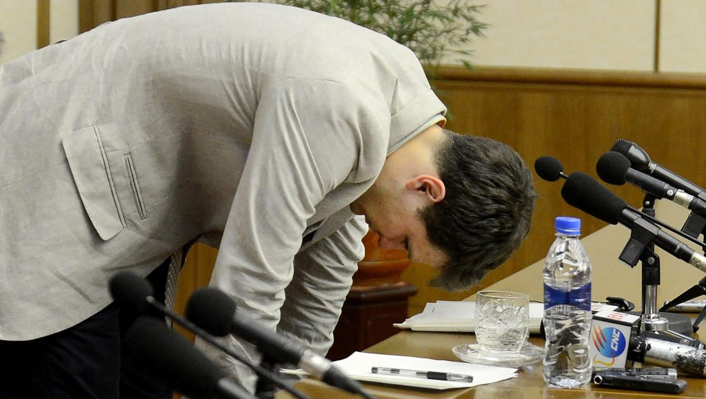 """This photo taken on February 29, 2016 and released by North Korea's official Korean Central News Agency (KCNA) on March 1, 2016 shows US student Otto Frederick Warmbier (R), who is arrested for committing hostile acts against North Korea, bowing  at a press conference in Pyongyang. A US student arrested in North Korea has admitted to stealing propaganda material at the behest of a US Methodist church and with the encouragement of a secret university society, state media reported on February 29.   REPUBLIC OF KOREA OUT AFP PHOTO / KCNA via KNS THIS PICTURE WAS MADE AVAILABLE BY A THIRD PARTY. AFP CAN NOT INDEPENDENTLY VERIFY THE AUTHENTICITY, LOCATION, DATE AND CONTENT OF THIS IMAGE. THIS PHOTO IS DISTRIBUTED EXACTLY AS RECEIVED BY AFP. ---EDITORS NOTE--- RESTRICTED TO EDITORIAL USE - MANDATORY CREDIT """"AFP PHOTO/KCNA VIA KNS"""" - NO MARKETING NO ADVERTISING CAMPAIGNS - DISTRIBUTED AS A SERVICE TO CLIENTS / AFP PHOTO / KCNA / KCNA VIA KNS"""