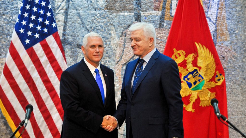 """US Vice President Mike Pence (L) shakes hands with Montenegro's Prime Minister Dusko Markovic (R) prior to their joint press conference in Podgorica on August 2, 2017.  US Vice President Mike Pence made his final stop on August 1 in Montenegro on an Eastern European tour aimed at reassuring US allies under """"Russian pressure"""", pledging the US President would sign off on new sanctions against Moscow """"soon"""". / AFP PHOTO / Savo PRELEVIC"""