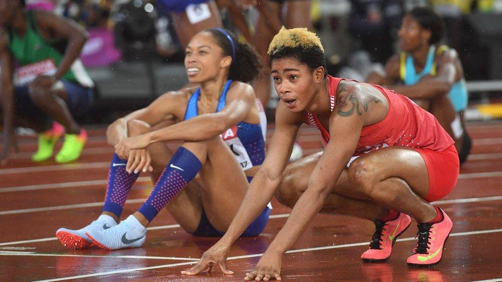 Bahrain's Salwa Eid Naser and US athlete Allyson Felix (L) react after coming in second and third respectively in the final of the women's 400m athletics event at the 2017 IAAF World Championships at the London Stadium in London on August 9, 2017. / AFP PHOTO / Kirill KUDRYAVTSEV