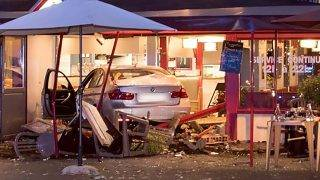 """This picture released on August 15, 2017 by the Fire department of Seine et Marne communication services (Sdis77) shows the car that smashed into a pizza restaurant in the town of Sept-Sorts, 55 kilometres (34 miles) east of Paris late on August 14, 2017, killing a girl aged 13 and seriously hurting four. Investigators said the young driver had tried to commit suicide and the incident was not terror-related, adding it was """"highly likely"""" the driver was under the influence. / AFP PHOTO / Sdis77 / Leonard ORTUSO / RESTRICTED TO EDITORIAL USE - MANDATORY CREDIT """"AFP PHOTO / Sdis77 / LEONARD ORTUSO"""" - NO MARKETING NO ADVERTISING CAMPAIGNS - DISTRIBUTED AS A SERVICE TO CLIENTS"""