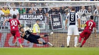 Juventus' goalkeeper Gianluigi Buffon saves a penalty kick  during the Italian Serie A football match Juventus vs Cagliari on August 19, 2017 at the Allianz Stadium in Turin. / AFP PHOTO / Marco BERTORELLO
