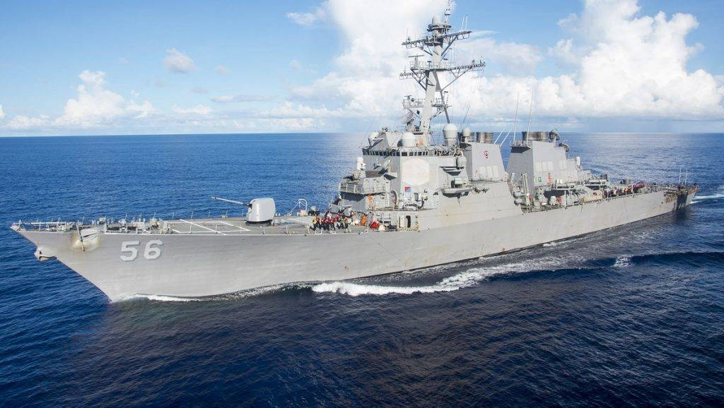 """This image released by the US Navy shows the Arleigh Burke-class guided-missile destroyer USS John S. McCain on June 14, 2017, in the Pacific Ocean.  In a statement, the US Navy reports that the McCain was involved in a collision with the merchant vessel Alnic MC while underway east of Singapore and the Strait of Malacca on August 21, 2017. The collision was reported at 6:24 a.m. Japan Standard Time, while the ship was transiting to a routine port visit in Singapore. Initial reports indicate McCain sustained damage to her port side aft. Search and rescue efforts are underway in coordination with local authorities, according to the statement. / AFP PHOTO / US NAVY / Gavin Shields / RESTRICTED TO EDITORIAL USE - MANDATORY CREDIT """"AFP PHOTO /US NAVY / Mass Communication Specialist Seaman Apprentice Gavin Shields"""" - NO MARKETING NO ADVERTISING CAMPAIGNS - DISTRIBUTED AS A SERVICE TO CLIENTS"""