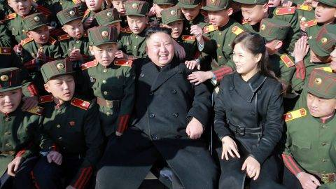 """(FILES) This file photo from North Korea's official Korean Central News Agency (KCNA) taken on March 2, 2017 and released on March 3, 2017 shows North Korean leader Kim Jong-Un (C) and his wife Ri Sol-Ju (front 2nd R) visiting the Mangyongdae Revolutionary School in Pyongyang. North Korean leader Kim Jong-Un has fathered another child, reports said on August 29, 2017, after his wife dropped out of the public eye for several months. First lady Ri Sol-Ju delivered the couple's third child in February, the Yonhap news agency reported Tuesday, citing South Korean lawmakers who were briefed by the National Intelligence Service. / AFP PHOTO / KCNA VIA KNS / STR / South Korea OUT / REPUBLIC OF KOREA OUT   ---EDITORS NOTE--- RESTRICTED TO EDITORIAL USE - MANDATORY CREDIT """"AFP PHOTO/KCNA VIA KNS"""" - NO MARKETING NO ADVERTISING CAMPAIGNS - DISTRIBUTED AS A SERVICE TO CLIENTS THIS PICTURE WAS MADE AVAILABLE BY A THIRD PARTY. AFP CAN NOT INDEPENDENTLY VERIFY THE AUTHENTICITY, LOCATION, DATE AND CONTENT OF THIS IMAGE. THIS PHOTO IS DISTRIBUTED EXACTLY AS RECEIVED BY AFP.  /"""
