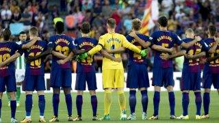 BARCELONA, SPAIN - AUGUST 20 : Players of Barcelona stand in silence during a commemoration for the victims those who lost their lives in terror attack, prior the match of the Spanish La Liga match between FC Barcelona and Real Betis in Barcelona, Spain on August 20, 2017. Albert Llop / Anadolu Agency