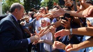 ISTANBUL, TURKEY - AUGUST 18:  Turkish President Recep Tayyip Erdogan greets people after performing the Friday Prayer in Istanbul, Turkey on August 18, 2017.  Kayhan Ozer / Anadolu Agency