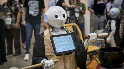 Pepper human-shaped robot while celebrating the Buddhist funeral rites to the Tokyo Int'l Funeral & Cemetery Show in Tokyo August 23, 2017. Hundreds of funeral home operators, cemeteries operators, crematorium operators, traders, suppliers, buyers, professional associations and investors gather at this professional funeral event in Japan.  (Photo by Alessandro Di Ciommo/NurPhoto)