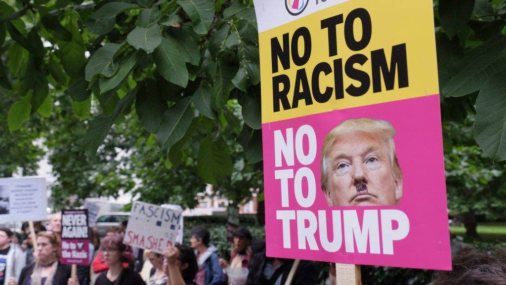 People gather to stage a demonstration as they hold placards during the 'Stand up to Racism' protest outside the US Embassy in London on August 14, 2017. Anti-racism group stages protest outside the US Embassy following the murder of activist Heather Heyer at a counter-protest to a far-right during recent protests in Charlottesville, Virginia. (Photo by Jay Shaw Baker/NurPhoto)