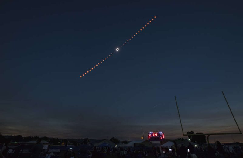 This composite image shows the progression of a total solar eclipse over Madras, Oregon on Monday, Aug. 21, 2017. A total solar eclipse swept across a narrow portion of the contiguous United States from Lincoln Beach, Oregon to Charleston, South Carolina. A partial solar eclipse was visible across the entire North American continent along with parts of South America, Africa, and Europe.  Photo Credit: (NASA/Aubrey Gemignani)