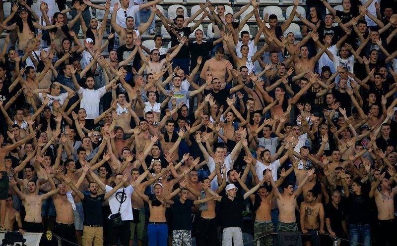 BELGRADE, SERBIA - AUGUST 29. FK Partizan supporters cheer their team during the Serbia Super League match between FK Partizan and OFK Belgrade at Partizan stadium August 29, 2015 in Belgrade, Serbia. (Photo by Srdjan Stevanovic/Getty Images)