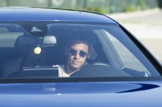 Barcelona's Brazilian forward Neymar drives into the parkinglot to takes part in a training session at the Sports Center FC Barcelona Joan Gamper in Sant Joan Despi, near Barcelona on August 2, 2017 following rumour that Neymar is considering a move to French club PSG for which the club would have to shell out some 222 million euros, enough to trigger the 25-year-old's transfer release clause. / AFP PHOTO / Josep LAGO
