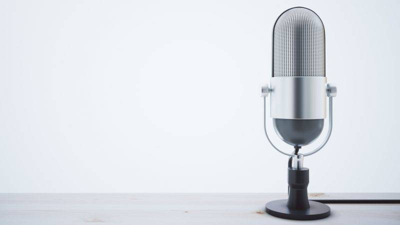 Light wooden surface with microphone on white background with copy space. 3D Rendering