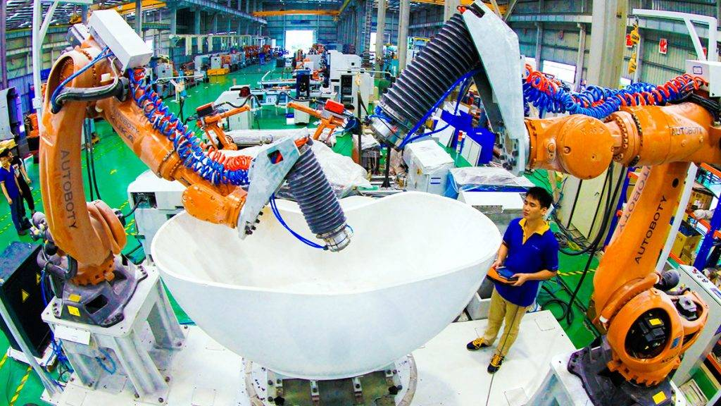 --FILE--A Chinese worker tests robot arms for glazing bathroom products at the plant of Foshan LXD Robotics Co., Ltd. in Foshan city, south China's Guangdong province, 7 May 2015.Having devoured many of the world's factory jobs, China is now handing them over to robots. China already ranks as the world's largest market for robotic machines. Sales in 2014 grew 54% from a year earlier, and the boom shows every sign of increasing. China is projected to have more installed industrial robots than any other country by 2016, according to the International Federation of Robotics. China's emergence as an automation hub contradicts many assumptions about robots and the global economy. A confluence of economic forces is behind the trend in China. Labor costs, while low relative to advanced economies like the U.S., have soared. That has undermined the calculus that brought many of those jobs there in the first place. And new robot technology is cheaper and easier to use than ever before. In addition, many of China's fastest-growing industries, such as autos, tend to rely on automation regardless of where the factories are. Some jobs, such as delicate operations in electronics plants, can only be done with machines.