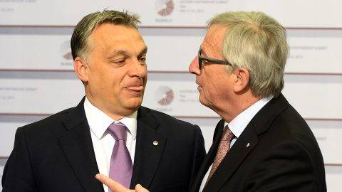 Hungarian Prime Minister Viktor Orban is greeted by President of the European Commission Jean-Claude Juncker on the second day of the fourth European Union (EU) eastern Partnership Summit in Riga, on May 22, 2015 as Latvia holds the rotating presidency of the EU Council. EU leaders and their counterparts from Ukraine and five ex-Soviet states hold a summit focused on bolstering their ties, an initiative that has been undermined by Russia's intervention in Ukraine. AFP PHOTO / JANEK SKARZYNSKI / AFP PHOTO / JANEK SKARZYNSKI