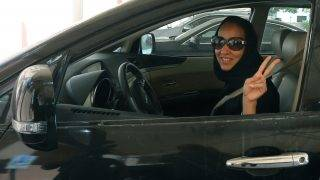 """TO GO WITH AFP STORY BY ACIL TABBARA  Saudi activist Manal Al Sharif, who now lives in Dubai, flashes the sign for victory as she drives her car in the Gulf Emirate city on October 22, 2013, in solidarity with Saudi women preparing to take to the wheel on October 26, defying the Saudi authorities, to campaign women's right to drive in Saudi Arabia. Under the slogan """" driving is a choice """", activists have called on social networks for women to gather in vehicles on October 26, the culmination of the campaign launched in September, in the only country in the world where women do not have the right drive. AFP PHOTO/MARWAN NAAMANI / AFP PHOTO / MARWAN NAAMANI"""