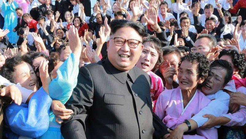 """This undated picture released from North Korea's official Korean Central News Agency (KCNA) on September 12, 2017 shows North Korean leader Kim Jong-Un (C) attending a photo session with teachers who volunteered to work at branch schools on islands and schools in forefront line and mountainous areas, in Pyongyang. / AFP PHOTO / KCNA VIA KNS / STR / South Korea OUT / REPUBLIC OF KOREA OUT   ---EDITORS NOTE--- RESTRICTED TO EDITORIAL USE - MANDATORY CREDIT """"AFP PHOTO/KCNA VIA KNS"""" - NO MARKETING NO ADVERTISING CAMPAIGNS - DISTRIBUTED AS A SERVICE TO CLIENTS THIS PICTURE WAS MADE AVAILABLE BY A THIRD PARTY. AFP CAN NOT INDEPENDENTLY VERIFY THE AUTHENTICITY, LOCATION, DATE AND CONTENT OF THIS IMAGE. THIS PHOTO IS DISTRIBUTED EXACTLY AS RECEIVED BY AFP.  /"""