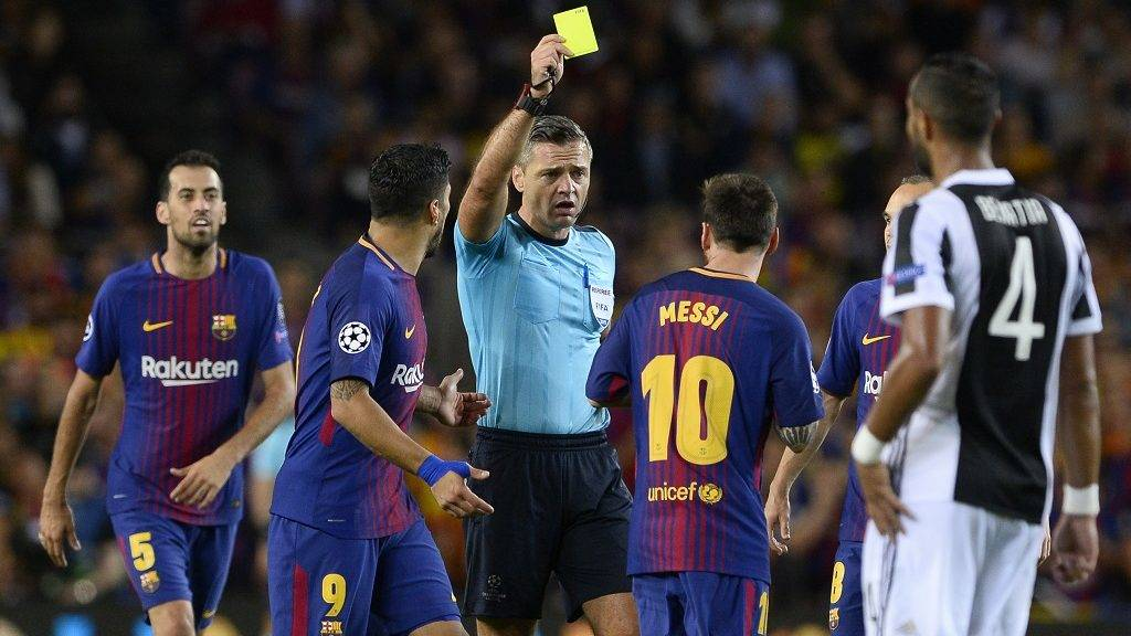 Barcelona's forward from Argentina Lionel Messi (10) receives a yellow card during the UEFA Champions League Group D football match FC Barcelona vs Juventus at the Camp Nou stadium in Barcelona on September 12, 2017. / AFP PHOTO / Josep LAGO
